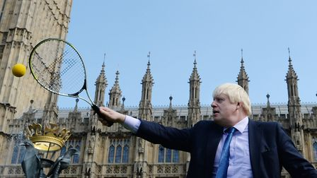 Boris Johnson plays tennis in the grounds of the Palace of Westminster in London. Photograph: Stefan