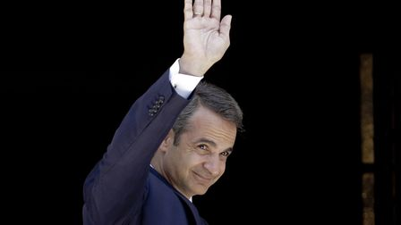 Prime Minister, Kyriakos Mitsotakis enters the Prime Minister's office at Maximos Mantion in Athens,