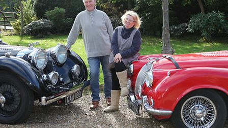 Brian Dodd and wife, Veronica, and their converted 1947 MKIV 3.5 ltr Jaguar (black) and 4.2ltr XK120