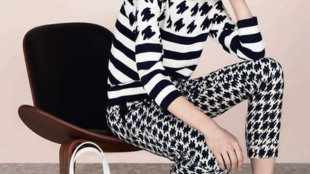 Houndstooth sweater, 150 by Jaeger with matching cigarette pant, 150, and Aimee bag, 350