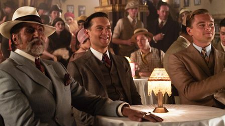 Amitabh Bachchan as Mayor Wolfshelm with Tobey Maguire as Nick Carraway and Leonardo DiCaprio as Gat