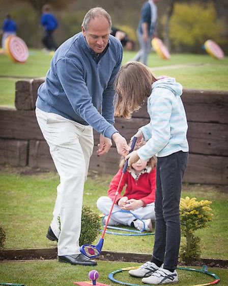 Sir Steve Redgrave helps a young lady