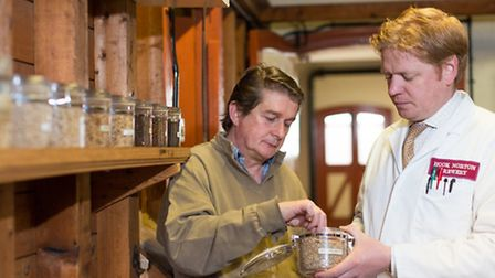Hugh Phillimore inspects the grain with head brewer James Clarke