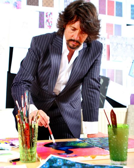Laurence painting in his Cirencester studio