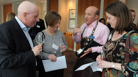 Mike and Yvonne Wasinski, Chris Pacey and Audry McKinstry examine a particularly fine vintage