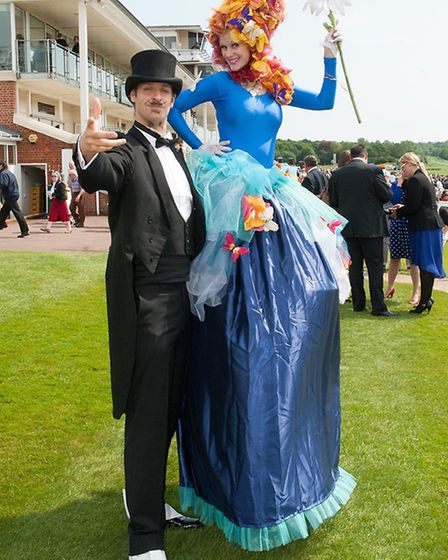 A magician and stilt-walker add colour to proceedings