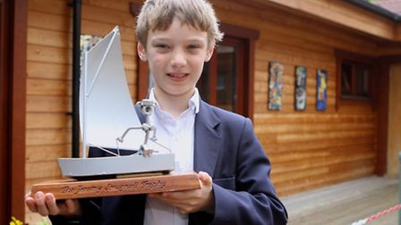 Kai with a model boat, but he is used to being in charge of a much bigger one.