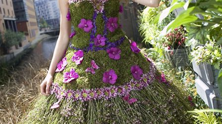 A blooming dress made entirely of flowers by Manchester Florist Lisa Dickinson of Venus, worn by Bos