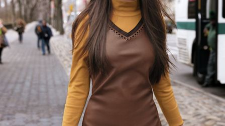 Brown leather dress with little laser-cut details at the neckline and hem, £145 worn over a light tu