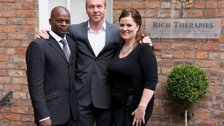 Rich Therapies co-founders Sylvan and Jay Richardson with Sir Chris Hoy - Jason Lock Photography