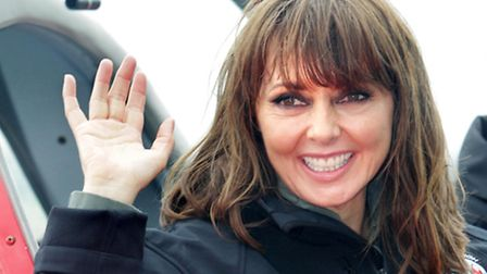 Carol Vorderman celebrates a successful flight in a Bulldog, an ex-RAF training plane