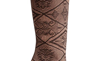 Brown tall, heeled boot, £555 by Marc Cain