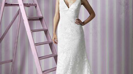 Martha; 1420 Feminine and sensual with a low cut V neckline and back detail make this French vintage