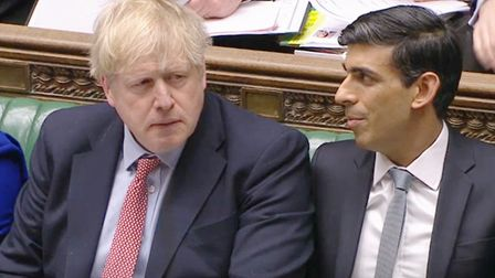 Prime Minister Boris Johnson (left) alongside Chancellor Rishi Sunak during Prime Minister's Questio