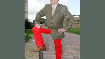 Mike Lowe bravely dons a pair of red trousers.