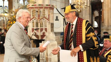 Joe Henson is presented fellowship by Brian Hilton, Chairman of Governors.