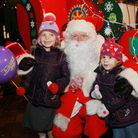 Santa meets sisters, Heather (4) and Lorelai Sanson (2) from Chester
