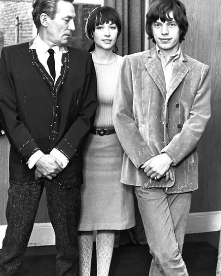Actor Peter Finch and Mick Jagger with Caroline Charles