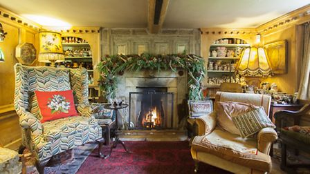 The Drawing Room fireplace dates back to the 1700s and is of limed oak. The wingback chair dates fro