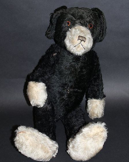 This black and white woodwool filled dog, probably by Farnell, should make £100 to £150