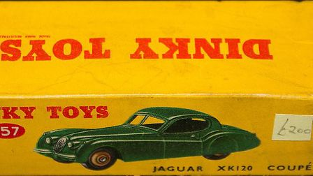 A Dinky Jaguar XK120 coupe number 157 carries an estimate of £100 to £150
