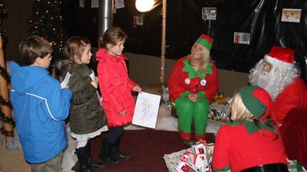 Thomas, Flora and Rose Willmington meeting Santa