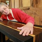 Suzanne Hodgson with her river table creation made from Ziricote inlaid veneer edged with solid scor
