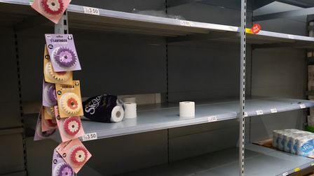 Empty shelves where toilet roll was on sale in an ASDA store. (Photo by Matthew Horwood/Getty Images