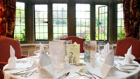 Tables laid awaiting guests at Buckland Manor