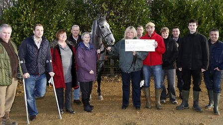 The Peoples Horse with rugby star James Simpson-Daniel presenting prize money to Grace Muir, Chief E