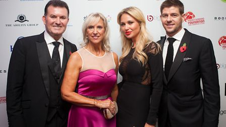 Marcus Magee, general manager of the Hilton, Liverpol, and his wife Janice with Alex and Steven Gerr