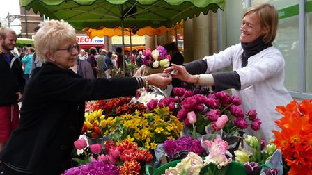 Buying tulips at Stroud Farmers' Market. Photo by Sara Chardin
