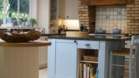 Pastel blue is a theme in the kitchen
