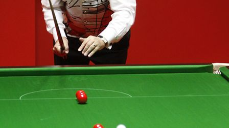 John Virgo takes to the table for one of his customary trick shots