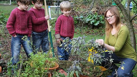 Jane Smith and boys, Lewis (7) and Ryan (7) and Justin (5) in the garden