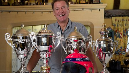 David Pinkney with some of his many racing trophies