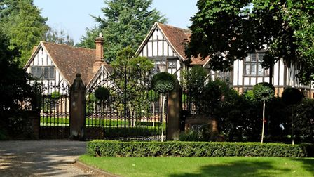 The gated entrance to the tudor mansion