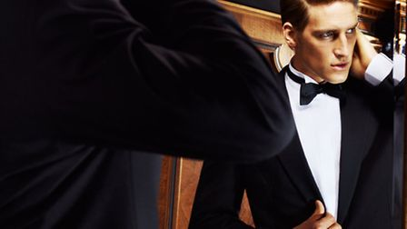Moss Hire Hilton dinnersuit, white dress shirt and black satin bow tie and cummerbund, available to