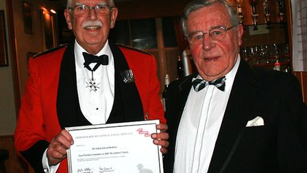 Colonel Stan Spackman, Chairman of E. Chesh. ABF The Soldiers' Charity, presenting certificate of lo