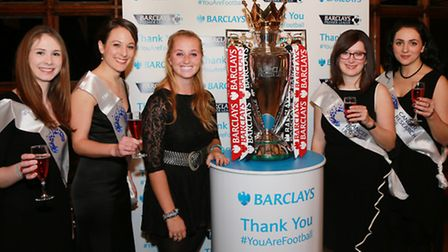 Ollie Battye with the Premier League trophy (centre) with Cancer Research UK girls,Lisa Jarrett, Sar