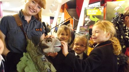 Shebbear College pupils meet one of the dinosaur stars of the show