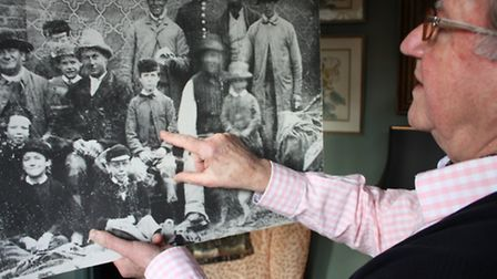 John pointing out his grandfather in a family portrait