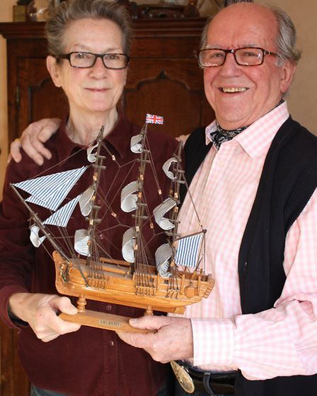 John with his wife Virginia and a model of the Bounty