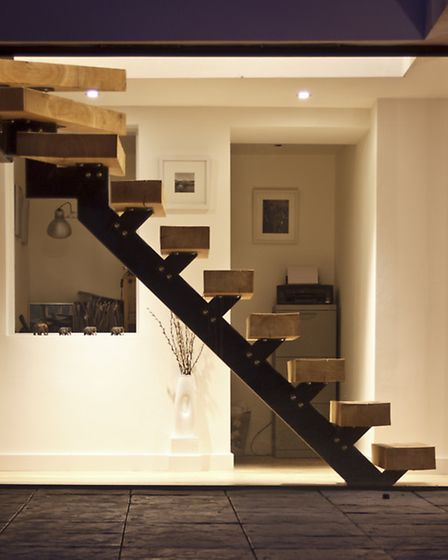 The stunning staircase is the focal point on the ground floor