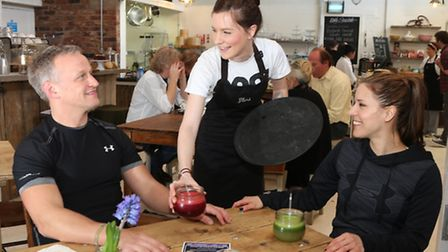 Lotte Butler and Dom Asquith at The Yard with waitess Kirsty Harris serving up some organic juice