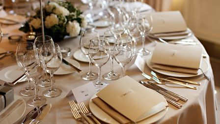 The tables prepared for a wedding reception