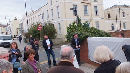 Supporters of the project gather at the street-facing wall of the Exmouth Arms pub in Bath Road, awa