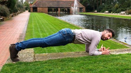 Michael Perry, team leader, demonstrates the 'plank' alongside the long pond at RHS Garden Wisley