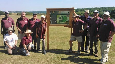 CMS volunteers with new signage for the meadow