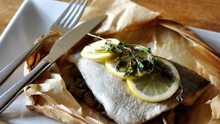 Wild black bream in a bag with chestnut mushrooms, parsley, thyme and garlic